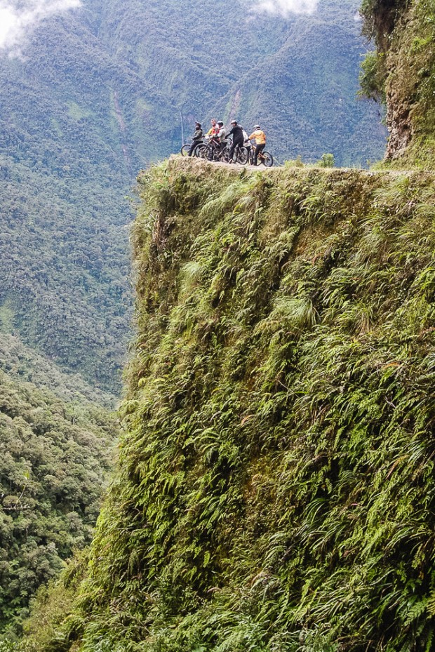 Standing Over Cliff Edge On Death Road In Bolivia