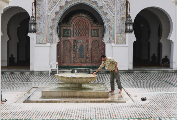 Man Cleaning Himself In Fes Mosque