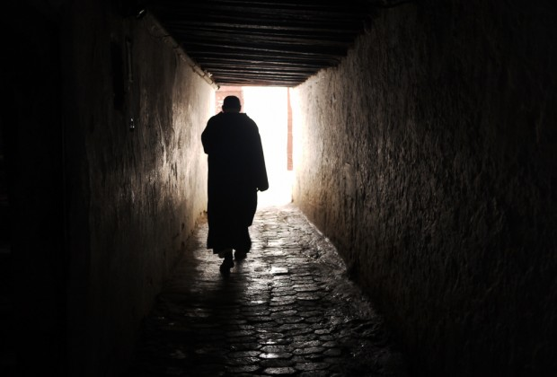 Moroccan Man Walking Through Fes Tunnel In Old Souk