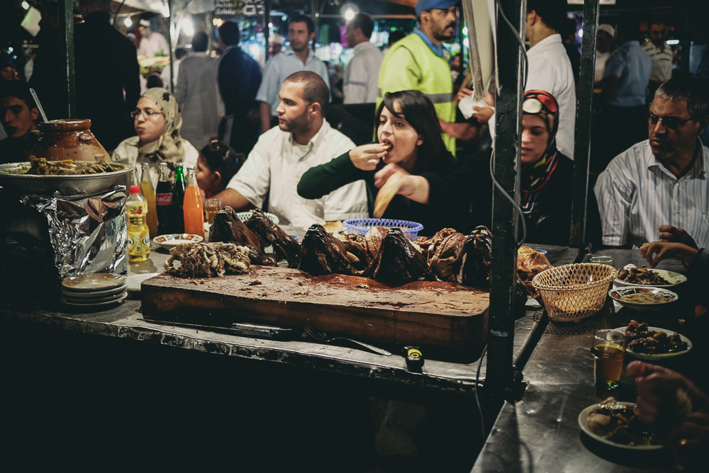 Woman Enjoying Lamb From Stall In Jamaa El Fna