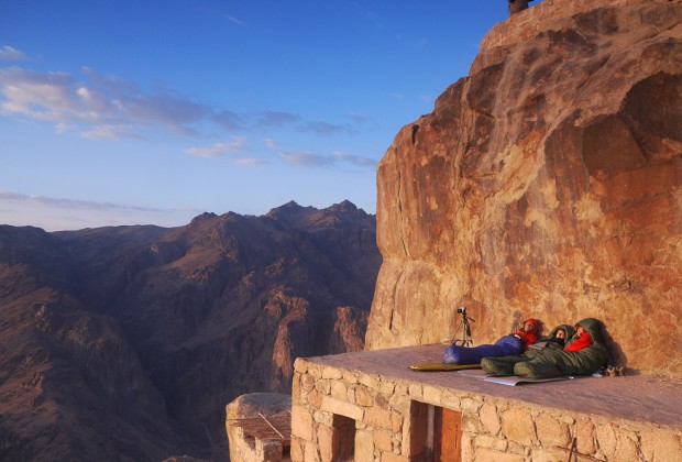 Prepared Hikers Waiting For The Sunrise On Mount Sinai In Sleeping Bags
