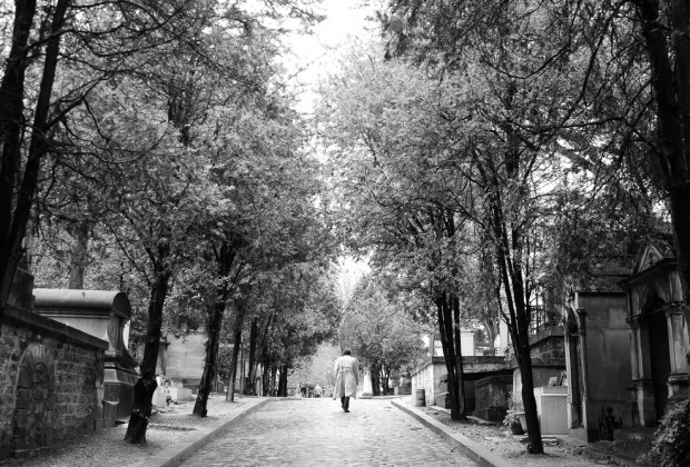 Man Walking In Pere Lachaise Cimetiere in Black and White