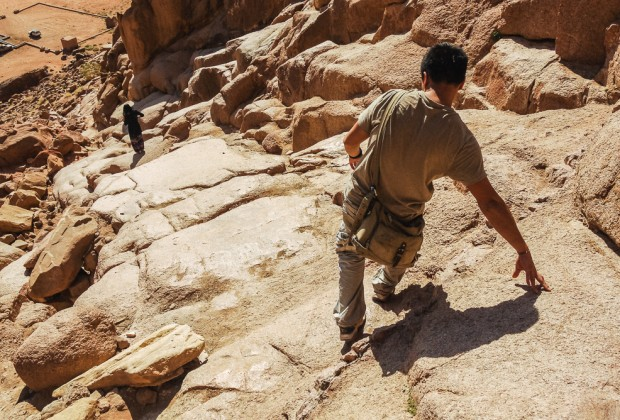 Kien Lam Scrambling Down Rocks In Wadi Rum